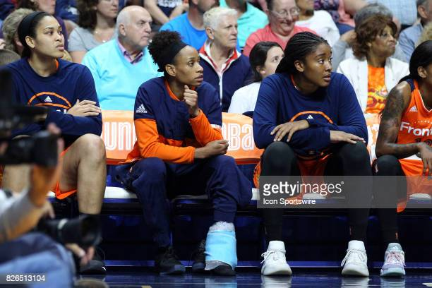 Connecticut Sun guard Jasmine Thomas looks on from the bench with an ice bag wrapped around her ankle during the second half of an WNBA game between...