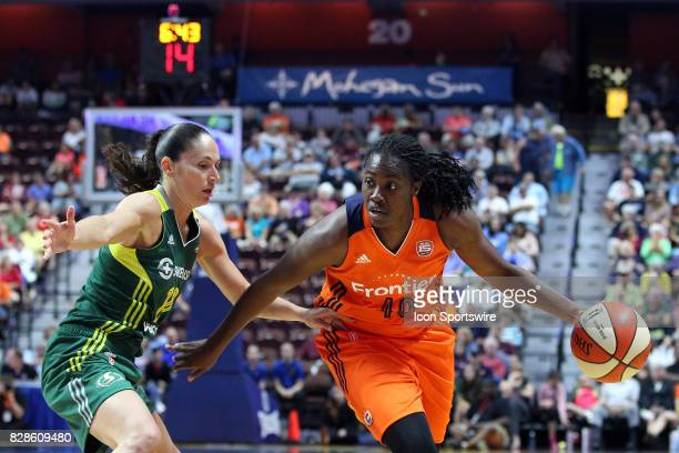 Connecticut Sun guard Shekinna Stricklen drives to the basket against Seattle Storm guard Sue Bird in action during the first half of an WNBA game...