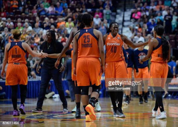 Connecticut Sun team celebrate after the Seattle Storm calls a pivotal timeout during the game as the Connecticut Sun host the Seattle Storm on...