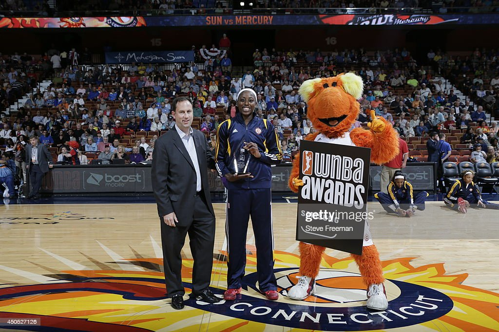 Connecticut Sun Vice President and General Manager Chris Sienko presents Chiney Ogwumike the WNBA Rookie of the Month Award before the game against the Phoenix Mercury on June 12, 2014 at Mohegan Sun Arena in Uncasville, Connecticut.