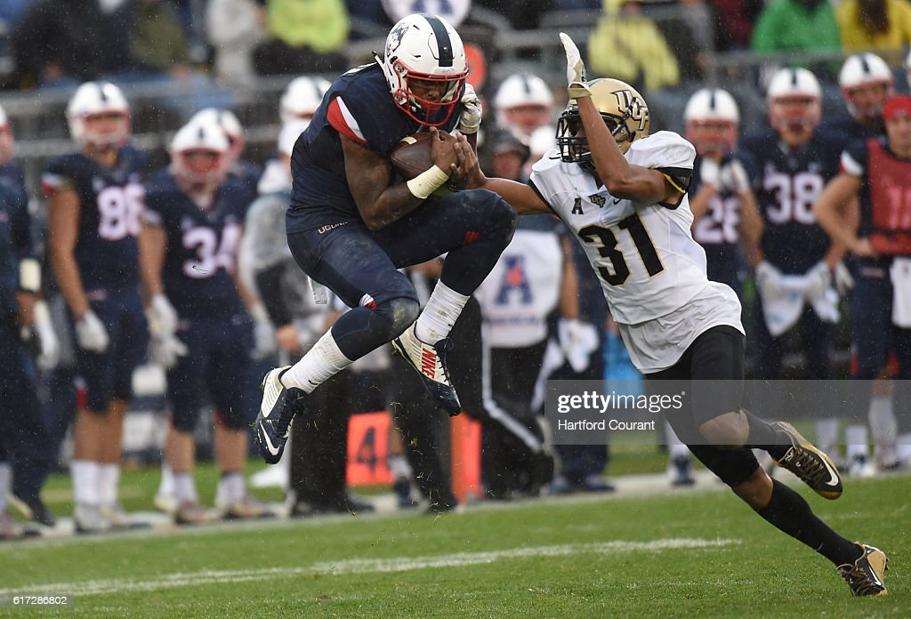 Connecticut wide receiver Noel Thomas (5) makes a reception in front of UCF defensive back Jeremy Boykins (31) at Rentschler Field in East Hartford, Conn., on Saturday, Oct. 22, 2016. UCF won, 24-16.