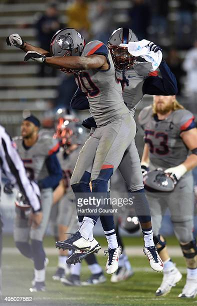 Connecticut wide receiver Thomas Lucas and safety Obi Melifonwu celebrate after a 3113 win against East Carolina at Pratt Whitney Stadium at...