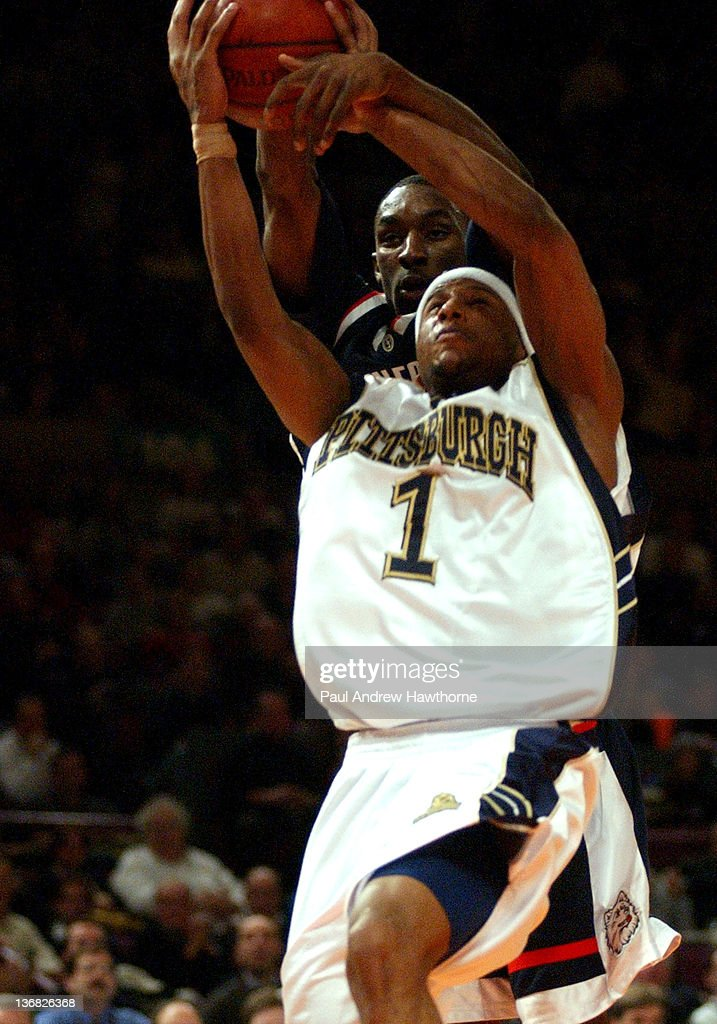 Connecticut's Ben Gordon fouls Pittsburgh's Julius Page during first half action at Madison Square Garden in New York City March 13 during the 2004...
