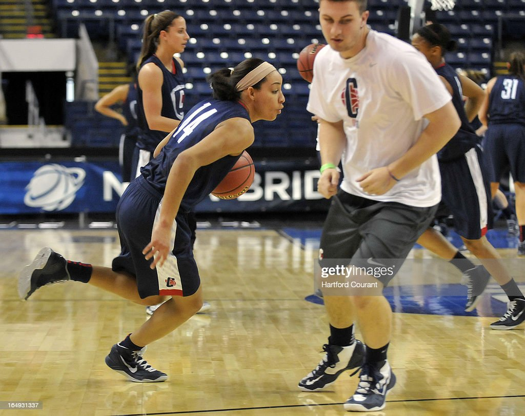 Connecticut's Bria Hartley drives around an assistant during practice for the NCAA Women's Basketball Tournament at the Webster Bank Arena at Harbor Yard in Bridgeport, Connecticut, Friday, March 29, 2013. The UConn women face Maryland in the Sweet 16.