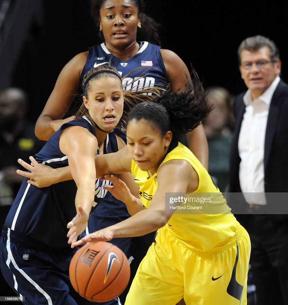 Connecticut's Caroline Doty guards Oregon's Ariel Thomas as Connecticut's Morgan Tuck, top, looks to assist at Matthew Knight Arena Monday, December 31, 2012, in Eugene, Oregon.