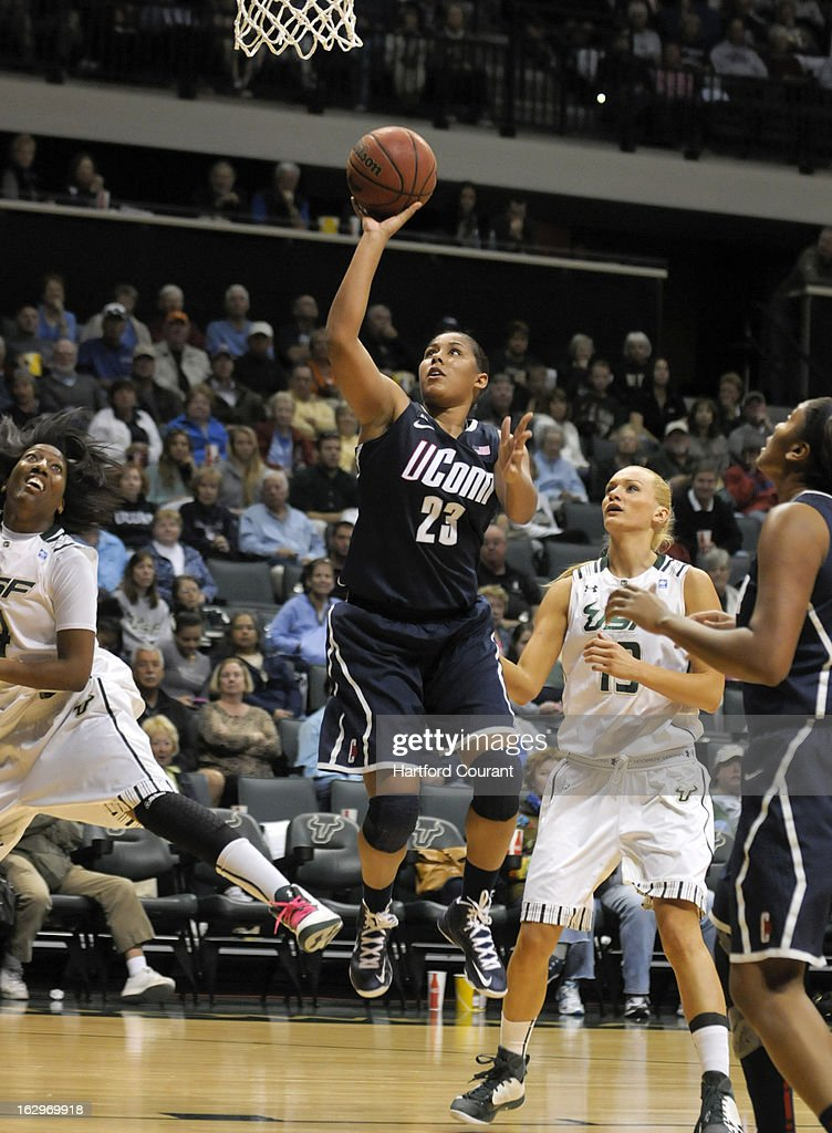 Connecticut's Kaleena Mosqueda-Lewis (23) drives to the basket against the University of South Florida at the Sun Dome in Tampa, Florida, Saturday, March 2, 2013. UConn defeated USF, 85-51.