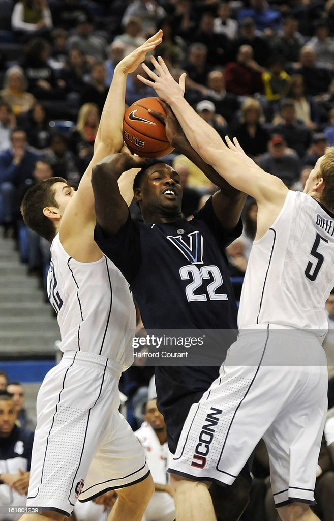 Connecticut's Leon Tolksdorf and Neils Giffey double tean Villanova forward JayVaughn Pinkston in the first half at the XL Center in Hartford, Connecticut, Saturday, February 16, 2013. Villanova defeated UConn, 70-61.