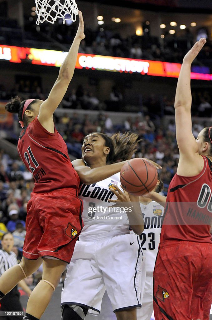 Connecticut's Morgan Tuck (3) loses the handle under pressure from Louisville's Bria Smith (21) and Sara Hammond (00) in the first half in the women's NCAA Tournament finals at New Orleans Arena in New Orleans, Louisiana, Tuesday, April 9, 2013. UConn won, 93-60.