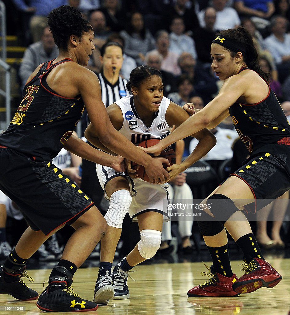 Connecticut's Moriah Jefferson, middle, is fouled driving to the hoop against Maryland's Alyssa Thomas (25) and Chloe Pavlech (15) during the second half in their East Region Sweet 16 game on Saturday, March 30, 2013, at the Webster Bank Arena at Harbor Yard in Bridgeport, Connecticut. UConn moved on, 76-50.