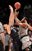Connecticut's Niels Giffey defends against Georgetown's Austin Freeman in the second half of the men's Big East basketball tournament at Madison...