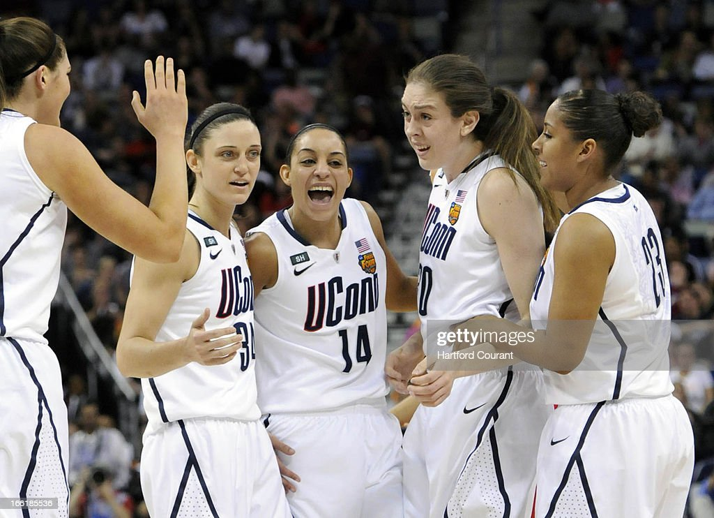 Connecticut's players rally around teammate Breanna Stewart after she was fouled in the first half against Louisville in the women's NCAA Tournament finals at New Orleans Arena in New Orleans, Louisiana, Tuesday, April 9, 2013. UConn won, 93-60.