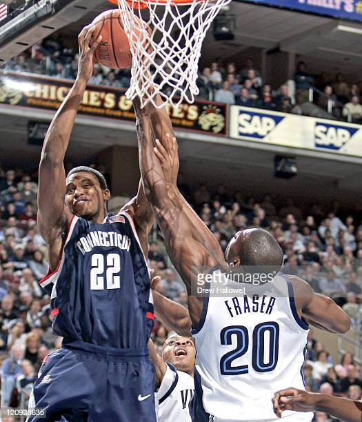 Connecticut's Rudy Gay grabs a rebound over Villanova's Jason Fraser Monday February 13 2006 at the Wachovia Center in Philadelphia PA