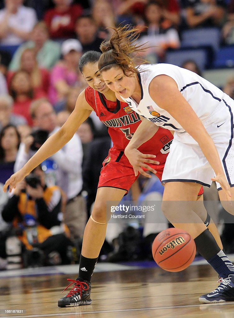 Connecticut's Stefanie Dolson, right, strips the ball from from Louisville's Sheronne Vails in the first half in the women's NCAA Tournament finals at New Orleans Arena in New Orleans, Louisiana, Tuesday, April 9, 2013. UConn won, 93-60.