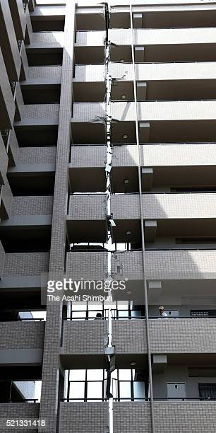 Connecting corridors of all floors are cracked at an apartment complex a day after the magnitude 65 earthquake on April 15 2016 in Kumamoto Japan At...