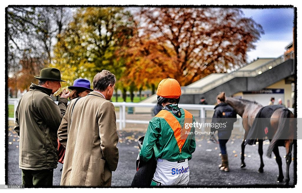 Connections chat after a race at Ascot racecourse on November 23, 2013 in Ascot, England.