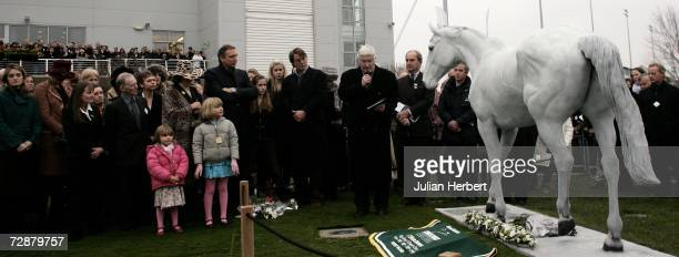 Connections of Desert Orchid gather round the statue for a memorial service of thanks giving for the popular horse that died recentley at Kempton...