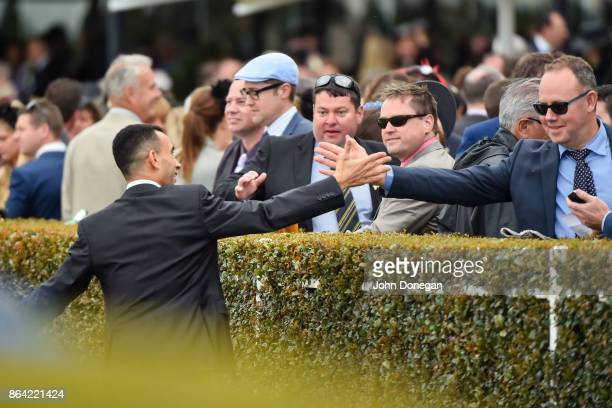 Connections of Fuhryk celebrate after winning the Carlton Draught Alinghi Stakes at Caulfield Racecourse on October 21 2017 in Caulfield Australia