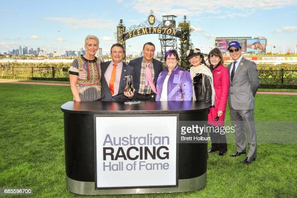 Connections of Guangzhou pose for photographers after winning the Winx Hall of Fame Trophy at Flemington Racecourse on May 20 2017 in Flemington...