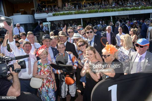 Connections of Hey Doc with Luke Currie after winning the Australian Guineas at Flemington Racecourse on March 04 2017 in Flemington Australia