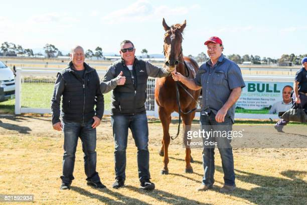Connections pose with Smooth Hustler after winning the Tambo Waste 3YO Maiden Plate at Bairnsdale Racecourse on July 25 2017 in Bairnsdale Australia