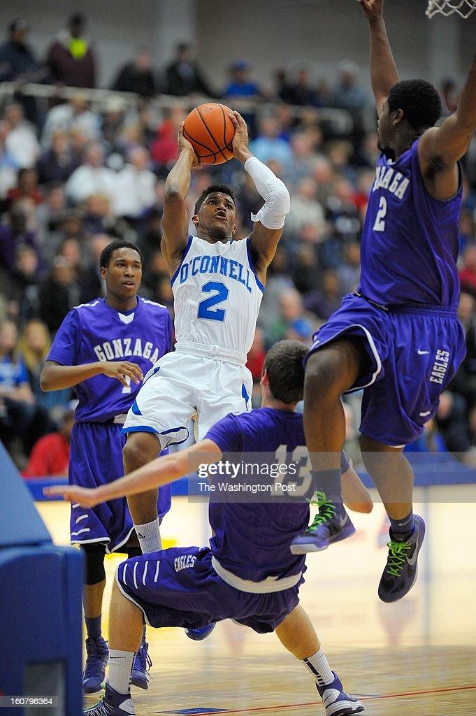 O'Connell's Kamrin Moore, center, fires a shoot over Gonzaga's Matt jackson, center, right, as Gonzaga defeats O'Connell 66 - 57 in boys basketball at Bender Arena in Washington DC, February5, 2012 .