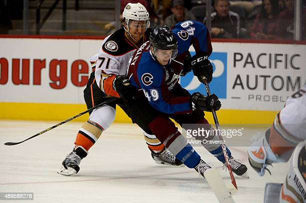 Conner Bleackley of the Colorado Avalanche scores a goal as Brandon Montour of the Anaheim Ducks defends during the first period on Tuesday September...