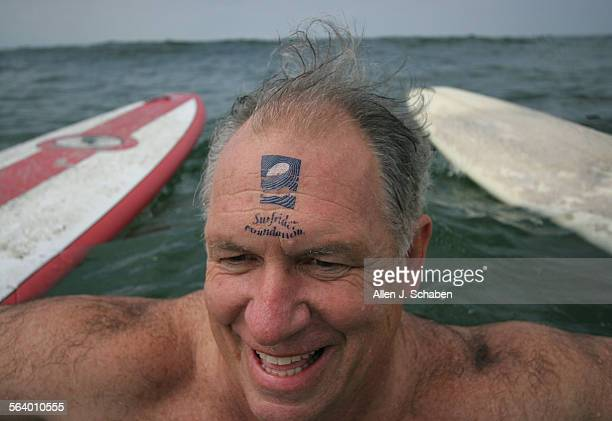 Conner Everts of Santa Monica sports a Surfrider tatoo on his forehead during the Surfrider Foundation's 'Paddle for Clean Water' where members and...