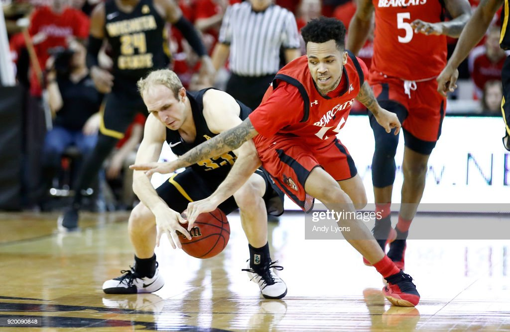 Conner Frankamp #33 of the Witchita State Shockers and Cane Broome #15 of the Cincinnati Bearcats rach for a loose ball during the Shockers 76-72 win at BB&T Arena on February 18, 2018 in Highland Heights, Kentucky.