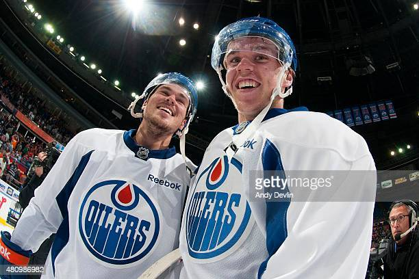 Conner McDavid and Greg Chase of the Edmonton Oilers smile between play at the Billy Moores Cup on July 6 2015 at Rexall Place in Edmonton Alberta...