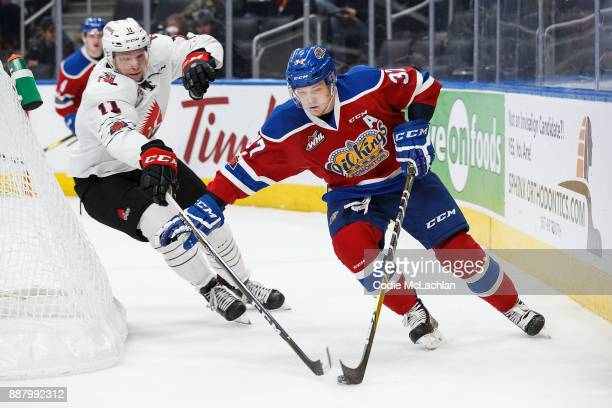 Conner McDonald of the Edmonton Oil Kings is pursued by Barrett Sheen of the Moose Jaw Warriors at Rogers Place on December 7 2017 in Edmonton Canada