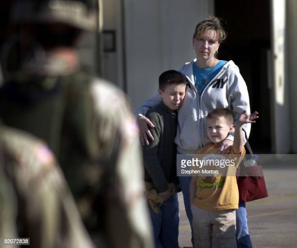 Conner Schaffer waves goodbye to his father US Army Spc Todd Schaffer as he stands with his brother Todd and his mother Denise Schaffer during the...
