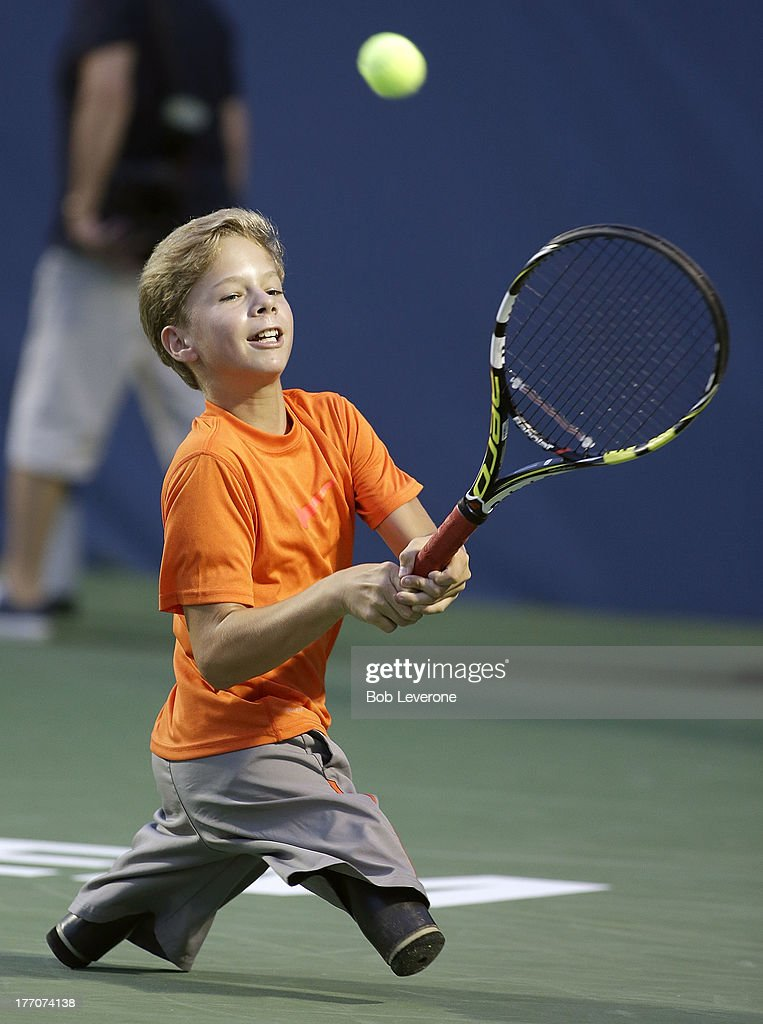 Conner Stroud, 13-years-old of Forest City, North Carolina, shows off his tennis skills during a exhibition for adaptive tennis on day three of the Winston-Salem Open on August 20, 2013 in Winston Salem, North Carolina.