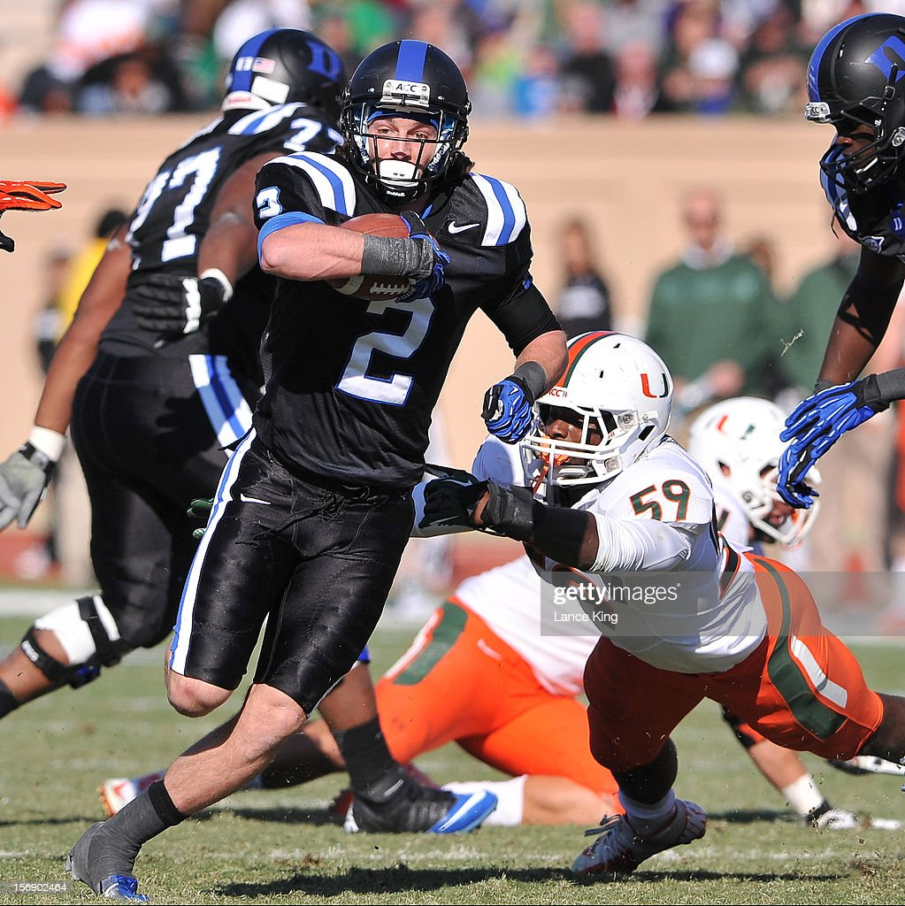 Conner Vernon #2 of the Duke Blue Devils avoids a tackle by Jimmy Gaines #59 of the Miami Hurricanes at Wallace Wade Stadium on November 24, 2012 in Durham, North Carolina.