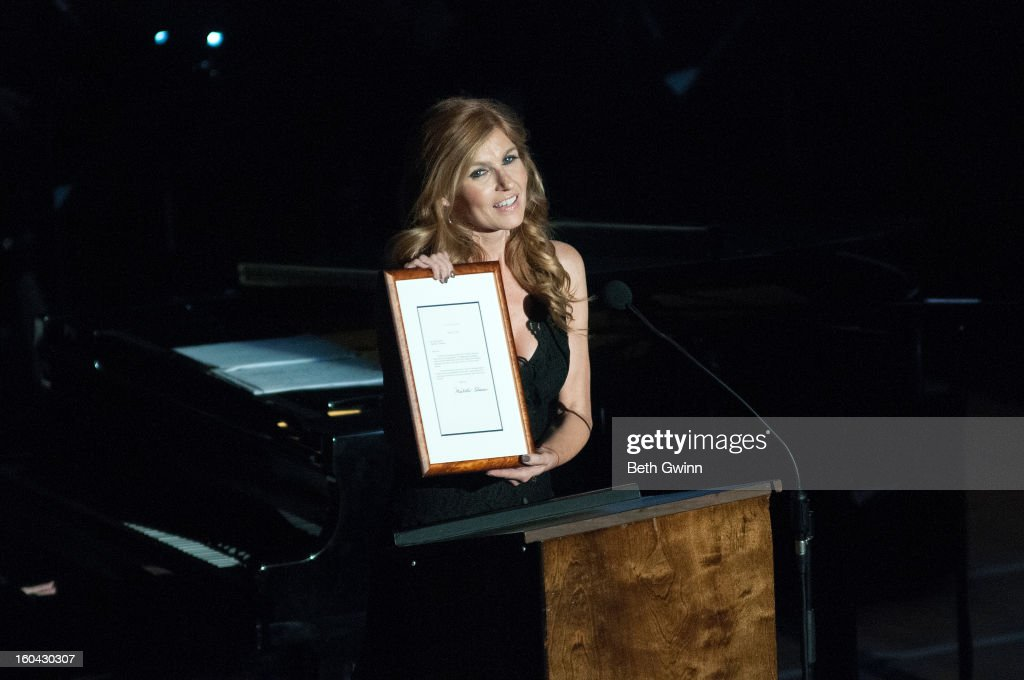 Connie Britton gives out an award during the Tribute to Cowboy Jack Clement at War Memorial Auditorium on January 30, 2013 in Nashville, Tennessee.