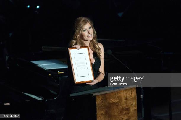 Connie Britton gives out an award during the Tribute to Cowboy Jack Clement at War Memorial Auditorium on January 30 2013 in Nashville Tennessee