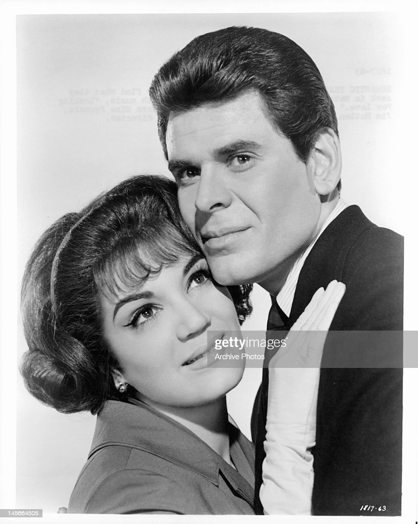 Connie Francis and Joby Baker embracing each other in a scene from the film 'Looking For Love' 1964
