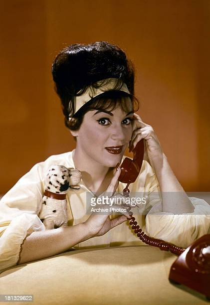 Connie Francis talks on the phone in publicity portrait for the film 'Follow The Boys' 1963