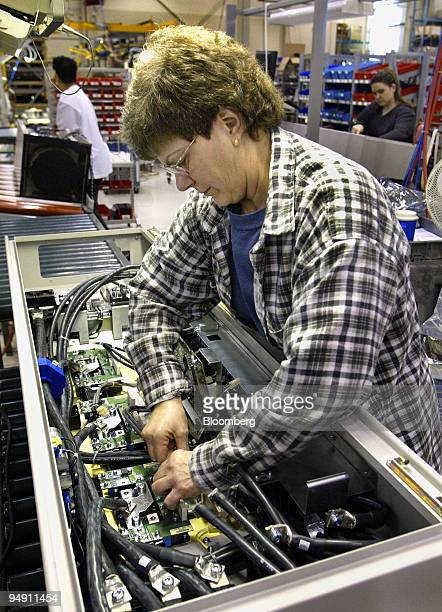 Connie Gill works in the pretesting area at the Danfoss Drives manufacturing plant in Rockford Illinois January 6 2004 Danfoss ran just one shift at...
