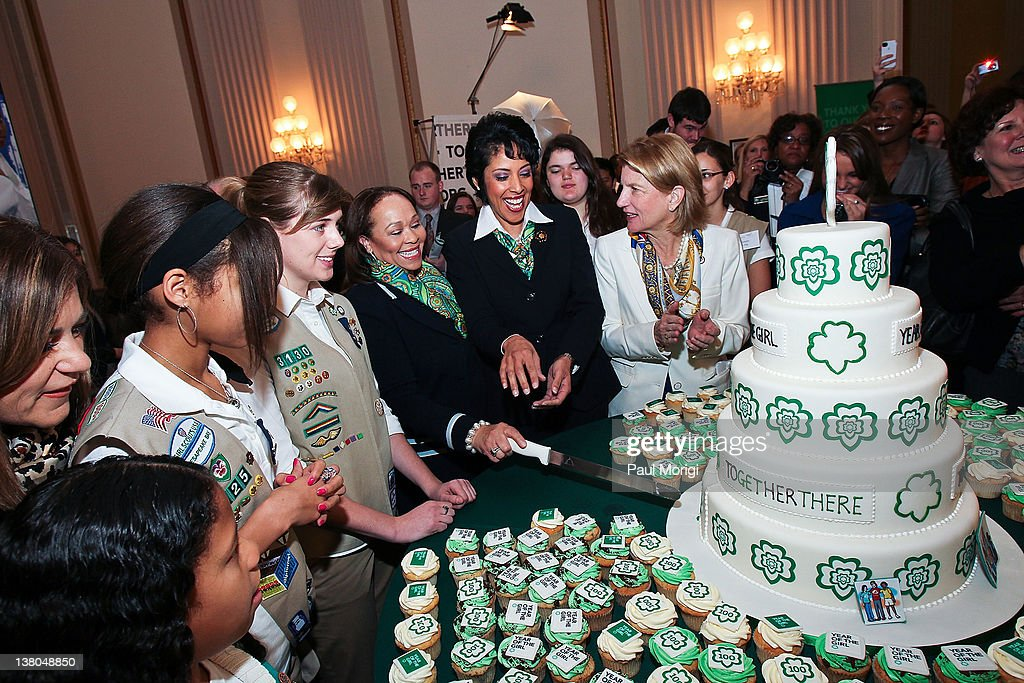 Connie L. Lindsey, National President, Girl Scouts of the USA, and Anna Maria Chavez, Chief Executive Officer of Girl Scouts of the USA, cut birthday cake at Girl Scouts At 100: The Launch of ToGetHerThere at Capitol Hill Cannon House Office Bldg, Caucus Room on February 1, 2012 in Washington, DC.