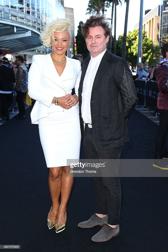 Connie Mitchell and Black Angus McDonald of Sneaky Sounds System arrive at the 27th Annual ARIA Awards 2013 at the Star on December 1 2013 in Sydney...