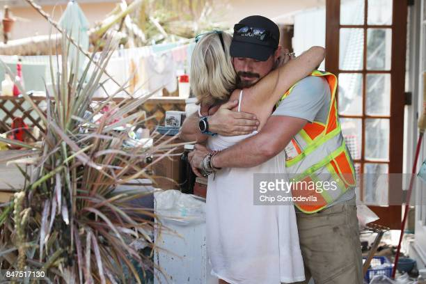 Connie Robertson embraces emergency rescue volunteer Ian Beaumont of Pennsylvania after he delivered some food and water September 15 2017 in...