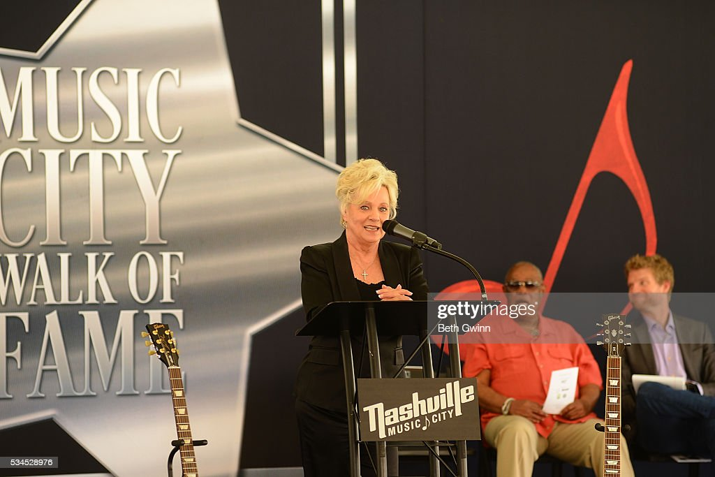 <a gi-track='captionPersonalityLinkClicked' href=/galleries/search?phrase=Connie+Smith&family=editorial&specificpeople=4305189 ng-click='$event.stopPropagation()'>Connie Smith</a> talks at Walk of Fame Park on May 26, 2016 in Nashville, Tennessee.