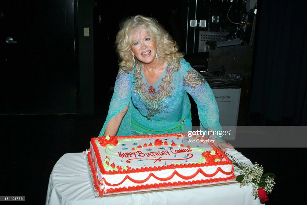 <a gi-track='captionPersonalityLinkClicked' href=/galleries/search?phrase=Connie+Stevens&family=editorial&specificpeople=217812 ng-click='$event.stopPropagation()'>Connie Stevens</a> receives a birthday cake from the cast of 'The Thunder Down Under'