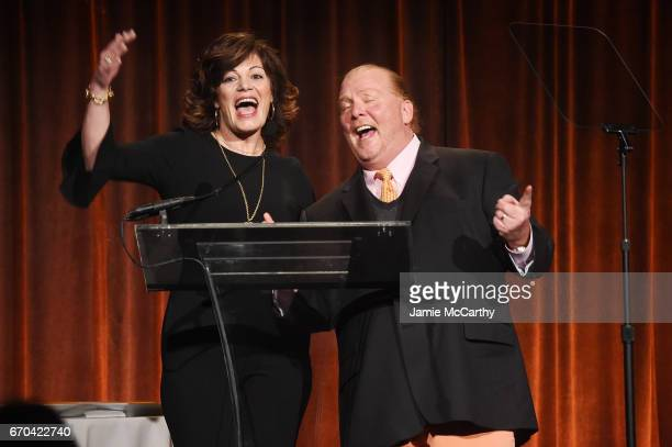 Connie Verducci and Mario Batali speak on stage at the Food Bank for New York City CanDo Awards Dinner 2017 on April 19 2017 in New York City