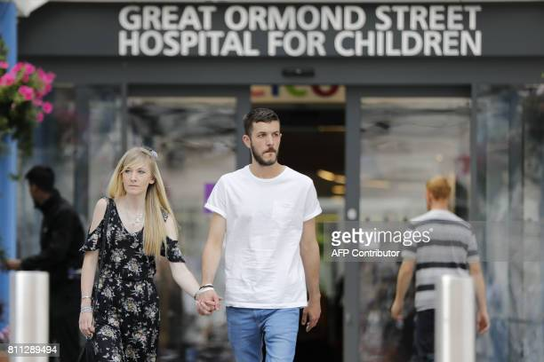 Connie Yates and Chris Gard parents of terminallyill 10monthold Charlie Gard walk out of the Great Ormond Street Hospital for Children after...