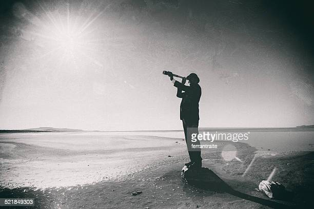 Connoisseur looks through spyglass in the dessert