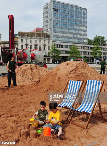 Connor aged two and brother Daniel Thistleton aged six from Sleaford make sandcastles whilst work gets underway with three hundred tonnes of sand at...