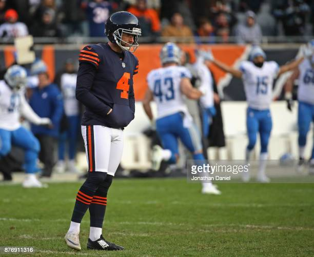 Connor Barth of the Chicago Bears walks off of the field after missing a gametying field goal in the last seconds against the Detroit Lions at...