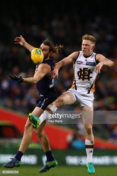 Connor Blakely of the Dockers and James Sicily of the Hawks contest for the ball during the round 18 AFL match between the Fremantle Dockers and the...