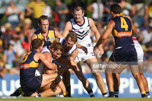 Connor Blakely of the Dockers gets tackled by Jack Redden of the Eagles during the JLT Community Series AFL match between the West Coast Eagles and...